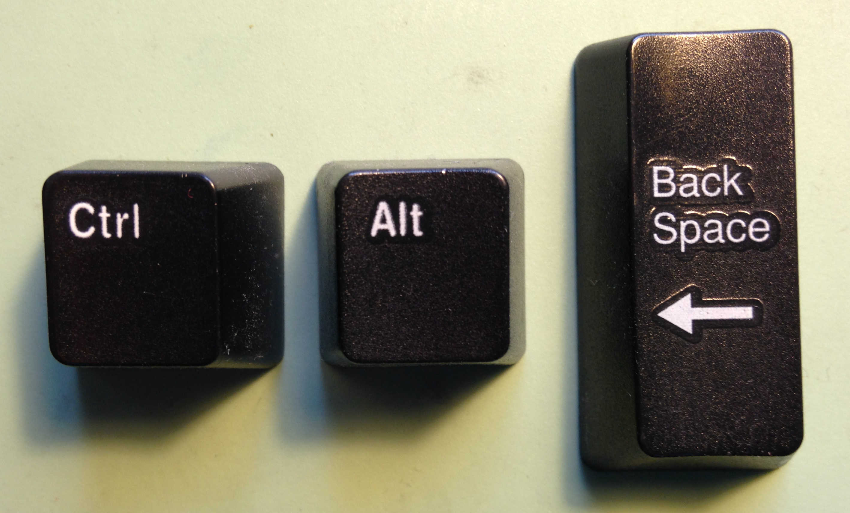 Keys arranged to show Ctrl-Alt-Backspace.